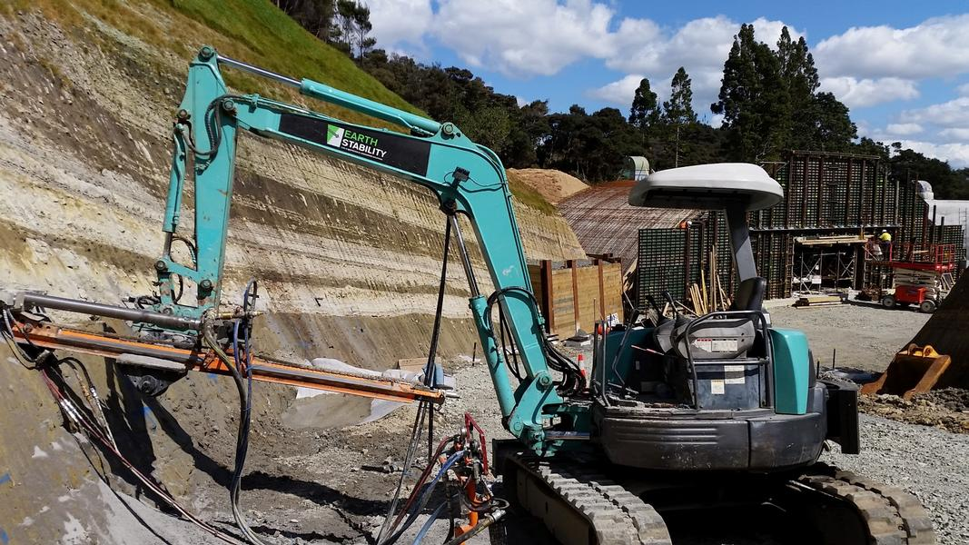 Drilling horizontal drains with excavator mounted rig (Large)