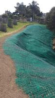 Completed Sloppe Stabilisation With Turf Reinforcement Matting And Rock Fall Mesh